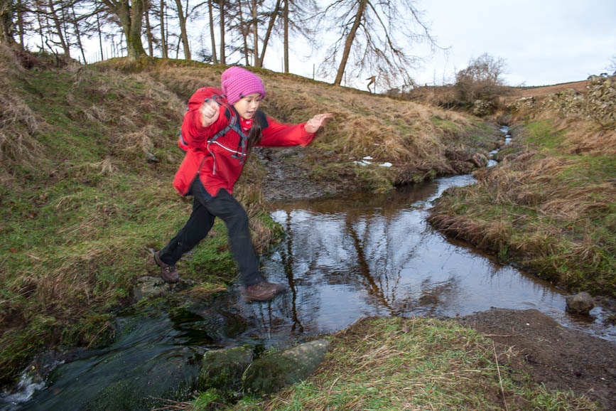 Jumping a stream on the way to Great Mell Fell
