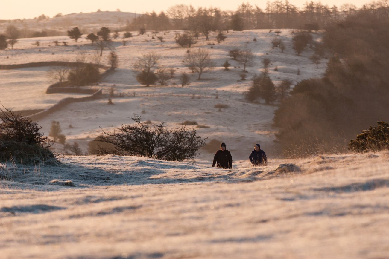 A couple walks along Cunswick Fell near Kendal