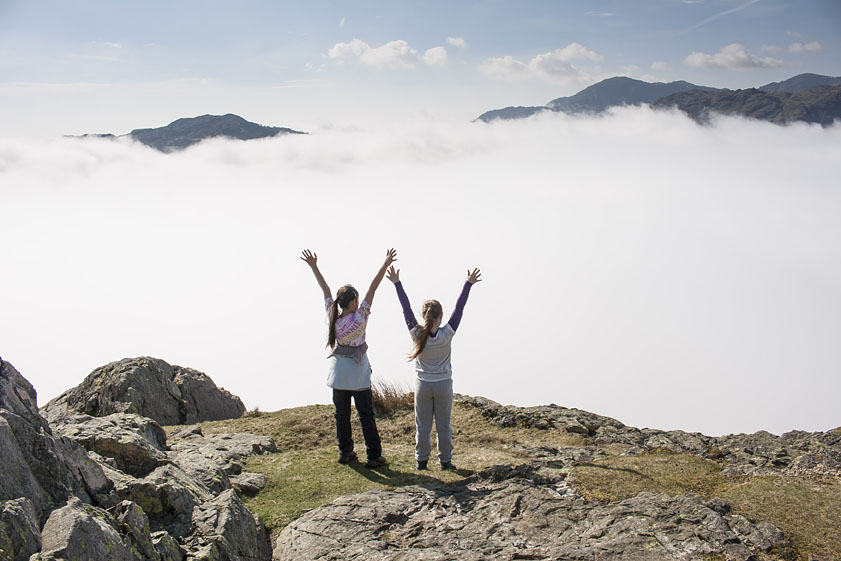 Hannah and Georgia celebrate their first temperature inversion, over Langdale, Cumbria