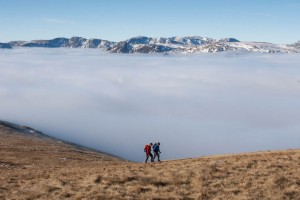 Walkers climb the slopes of Great Rigg
