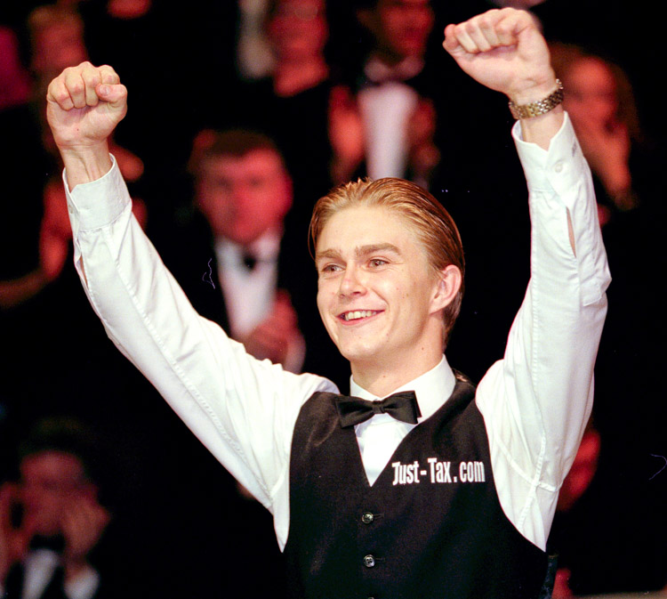 Paul Hunter raises his arms in victory after winning the Masters snooker